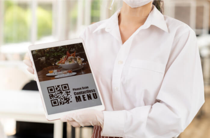 Woman showing a hospitality app